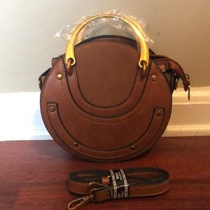 Brown and gold round crossbody bag
